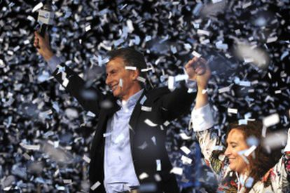 Outgoing Buenos Aires Mayor Mauricio Macri, left, holds hands with running mate Gabriela Michetti.
