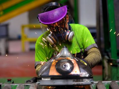 A worker at a recycling plant outside Madrid.