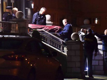 Police remove the body of David Byrne from the Regency Hotel in Dublin.