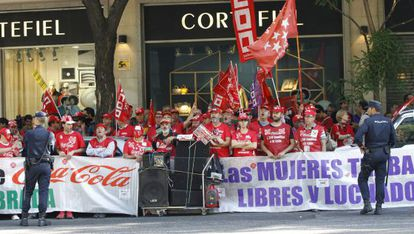 Coca-Cola workers protest against the layoffs.
