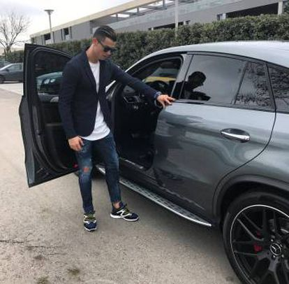 Cristiano Ronaldo with one of his luxury cars.
