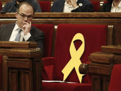 Catalan regional deputy Jordi Turull looks from his seat at the start of his investiture session.