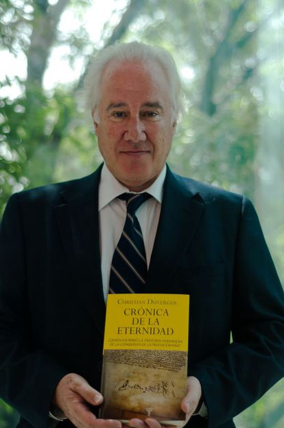 French historian Christian Duverger with his book.