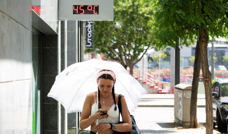 A woman walks in Lleida, which saw its highest temperature ever.
