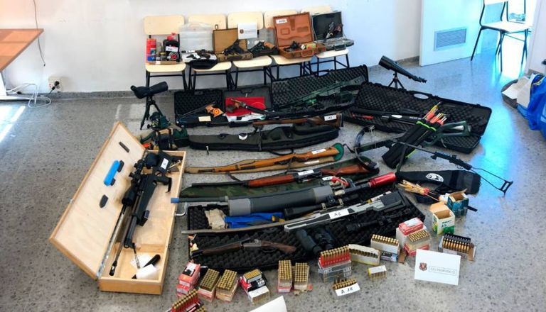 Weapons arsenal found in the apartment.