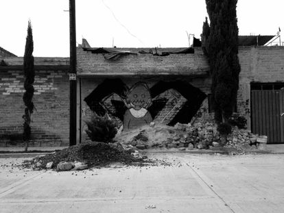 Graffiti in a neighborhood where one of the attacks took place.