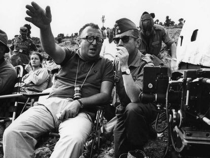 Sergio Leone and a Spanish soldier in July 1966.