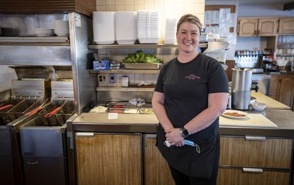 Trump supporter Megan Logan in the restaurant where she works as a waitress.