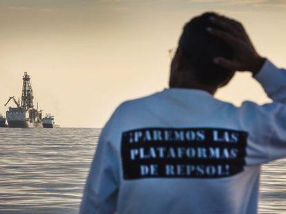 A conservationist observing Repsol's drilling ship last November.