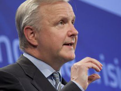 European Economic Commissioner Olli Rehn speaks during a media conference at EU headquarters in Brussels on Wednesday.
